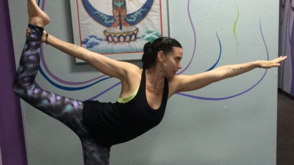Yoga teacher Erin Dunning shows the yoga pose, Lord of the Dance.