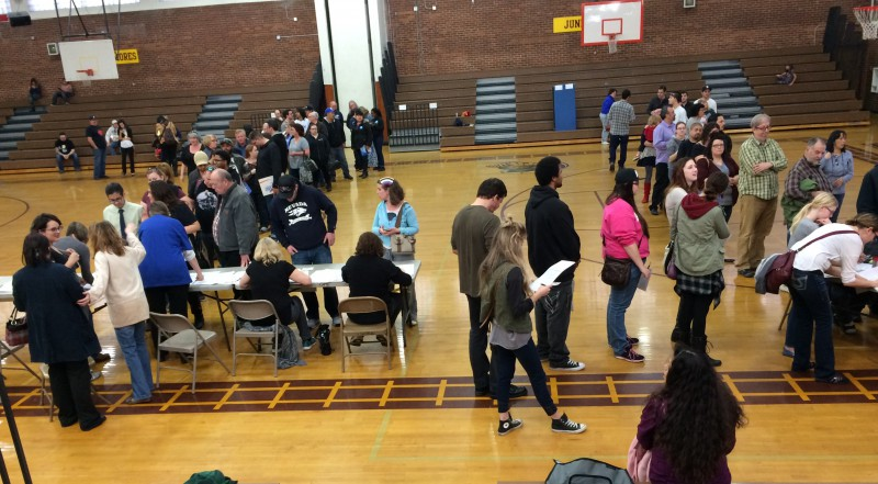 Voters wait to register in the Sparks High School gym. Due to a system glitch, many had to re-register to vote on the morning of the caucus.
