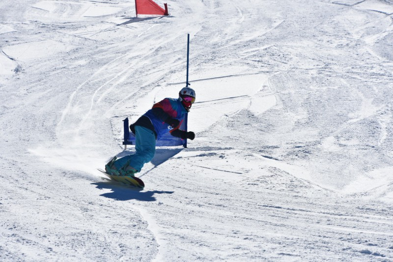 nior Abbie DeWit speeds past a gate during the snowboard team's final giant slalom race at AlpineMeadows. DeWit placed fourth overall.