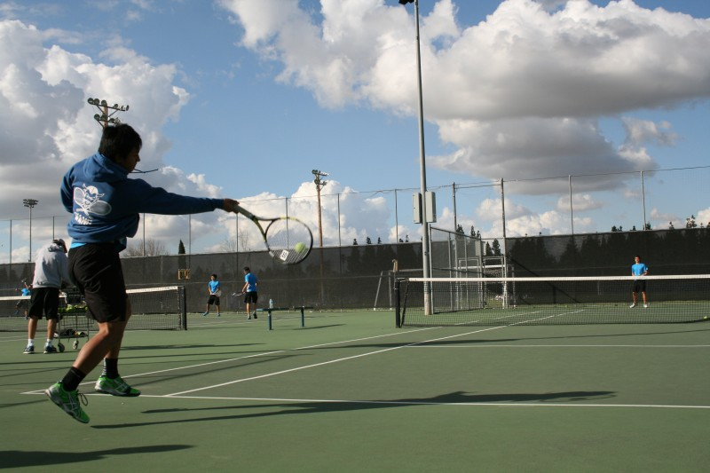 Senior David Wang practices before a tennis match against Elk Grove last year. (Photo: L. Su)