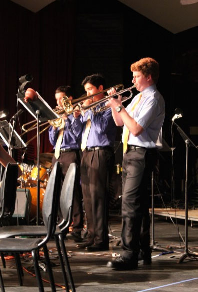 """The trumpet section of The Amazing Harper Alumni Jazz Band stand during a previous """"Coconut Grove"""" performance. (Photo: A Prime)"""