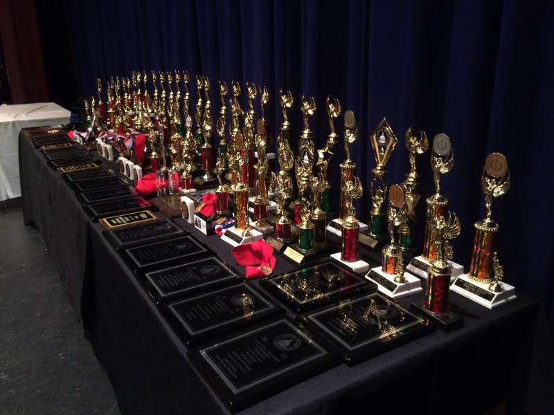 All the awards stacked on the table had been won by the Speech and Debate team in a short amount of only two years. Photo by Denna Changizi.