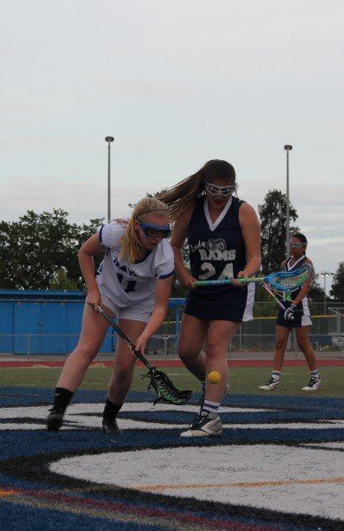Senior captain Sarah Sherwin rushes to get the ball before her opponent. Sherwin felt the game was relaxed and fun.