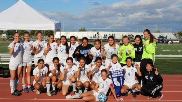 The undefeated Davis High women's soccer team poses with its section banner after a 1-0 section championship victory over Rocklin on Saturday, May 21.