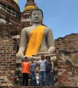 Sophomore Anika Kulkarni poses with her family in front of a Buddhist temple in Thailand. (courtesy photo A. Kulkarni)