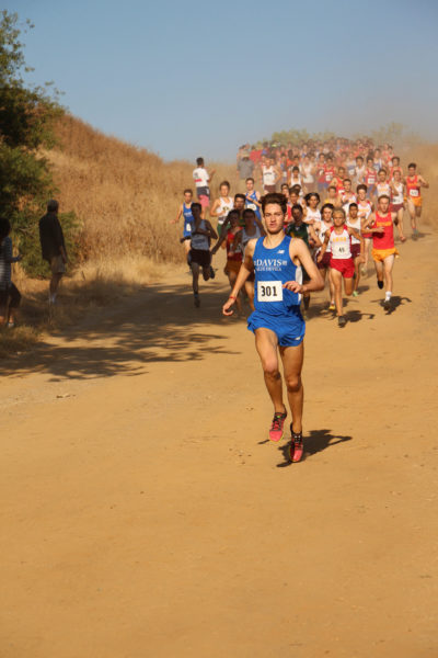 Michael Vernau leads the men's varsity race and breaks his last year's time of 15:00.6 with this year's time of 14:52.4.