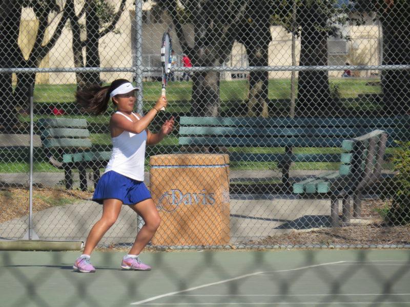 Senior Lauren Duan returns the tennis ball.