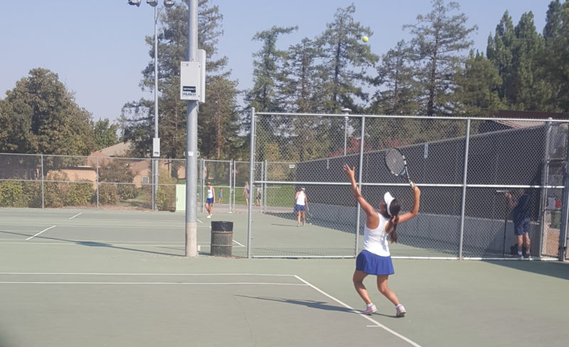 Senior and No. 1 singles player Lauren Duan aces her serve. Duan was the last singles match that day.