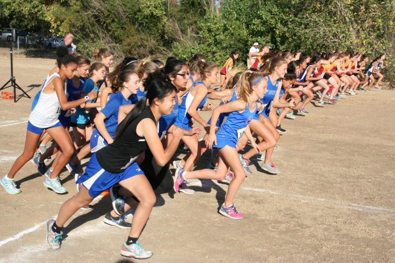 Frosh/soph women take off to their win at the Delta League Center meet.