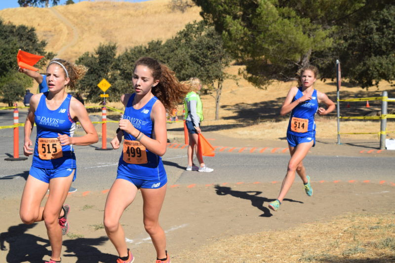 Sophomore Sophie Lodigiani races between sophomores Ruthie and Annie Mitchell at the first meet of the season in September: Lagoon Valley.