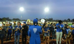 The DHS Pep Band gathers around the football field and begins to practice.