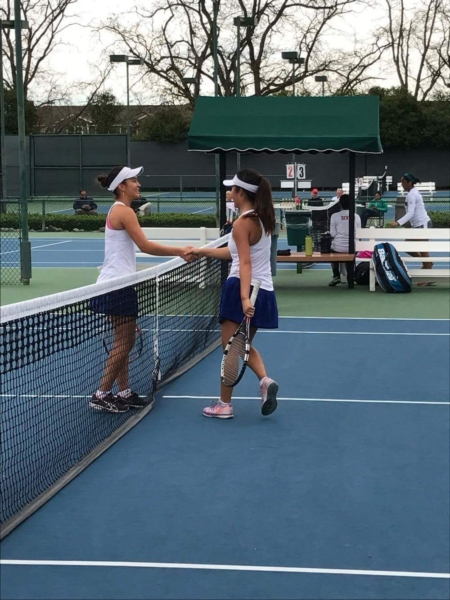 Sophomore Lillian Okamoto (left) and senior Lauren Duan shake hands after playing their semifinal match.