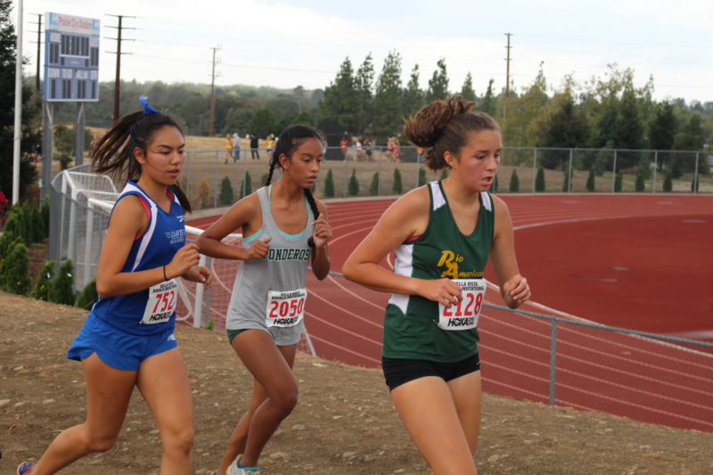 Senior Anna Young (24:10) sticks with a pack of girls in the 5,000 meter JV race. (Photo: A. Bobrowsky)