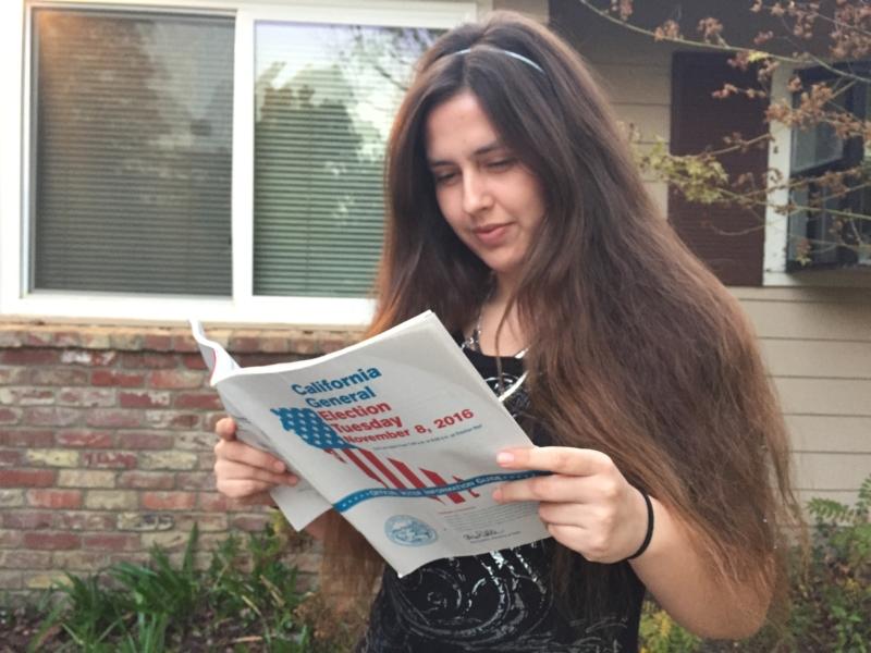 Senior Shailah Arreola-Bitner looks over the voter guide.