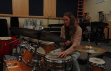 """Junior Kalia Mitchell-Silbaugh, the percussionist in the """"First Date"""" pit orchestra, practices in the music room."""