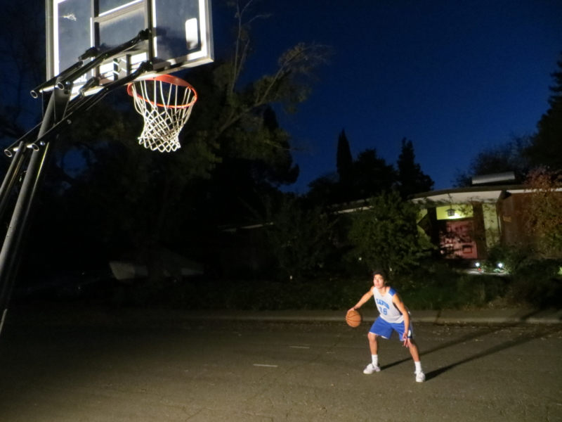 Even after dark, junior Quinn Vaewsorn's drive keeps him focused hard. As the varsity basketball player practices, he makes sure to prepare himself mentally.