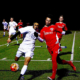 PHOTOS: Men's soccer ties up against rivals