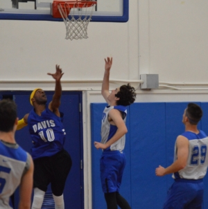 Students come out victorious against staff in basketball