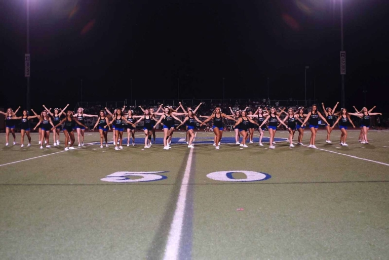 Cheerleaders prepare for the homecoming game
