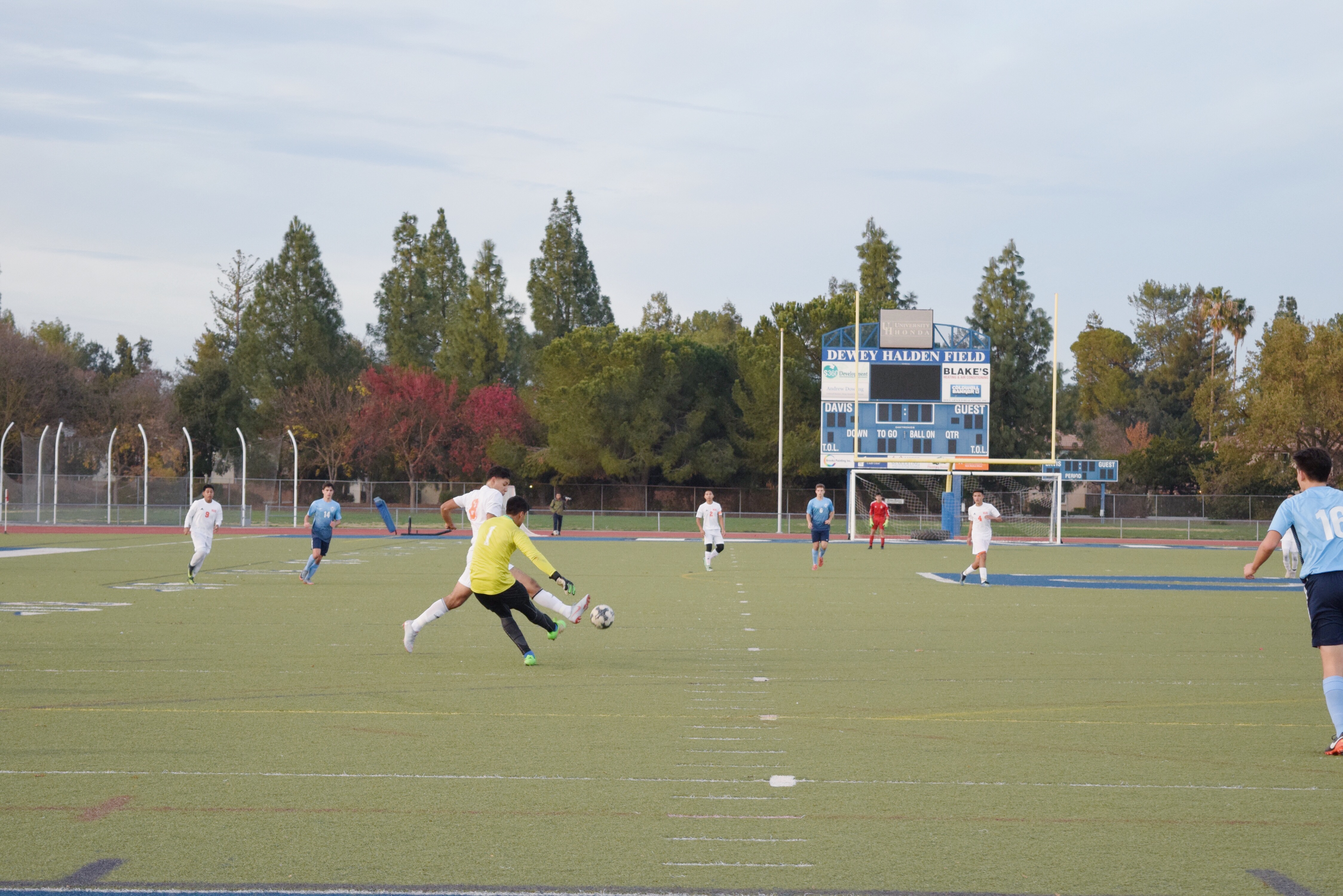 Goalkeeper Cory Kodira clears the ball away from a Woodland attacker.