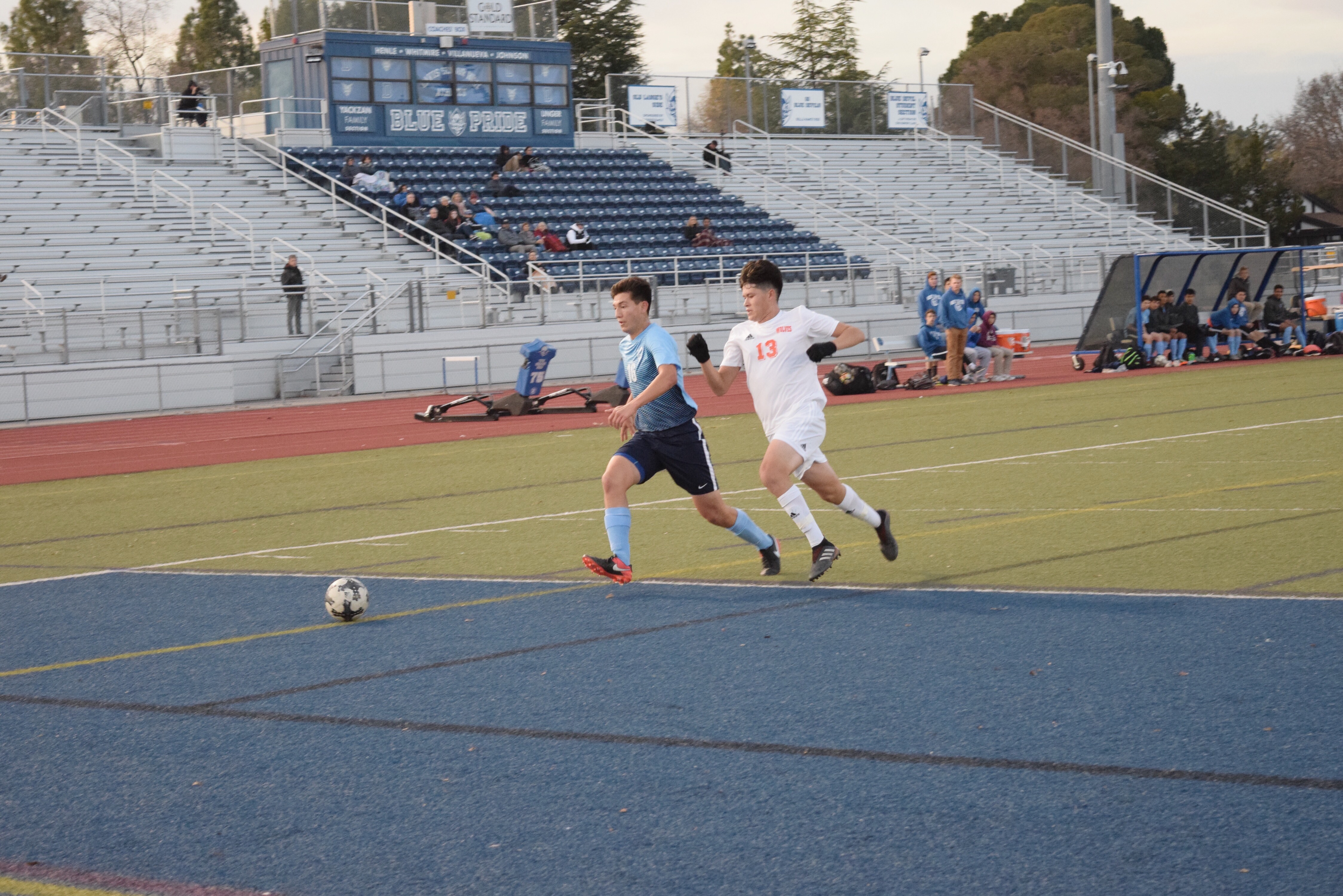 Senior Connor McCarty races for the ball down the sideline.