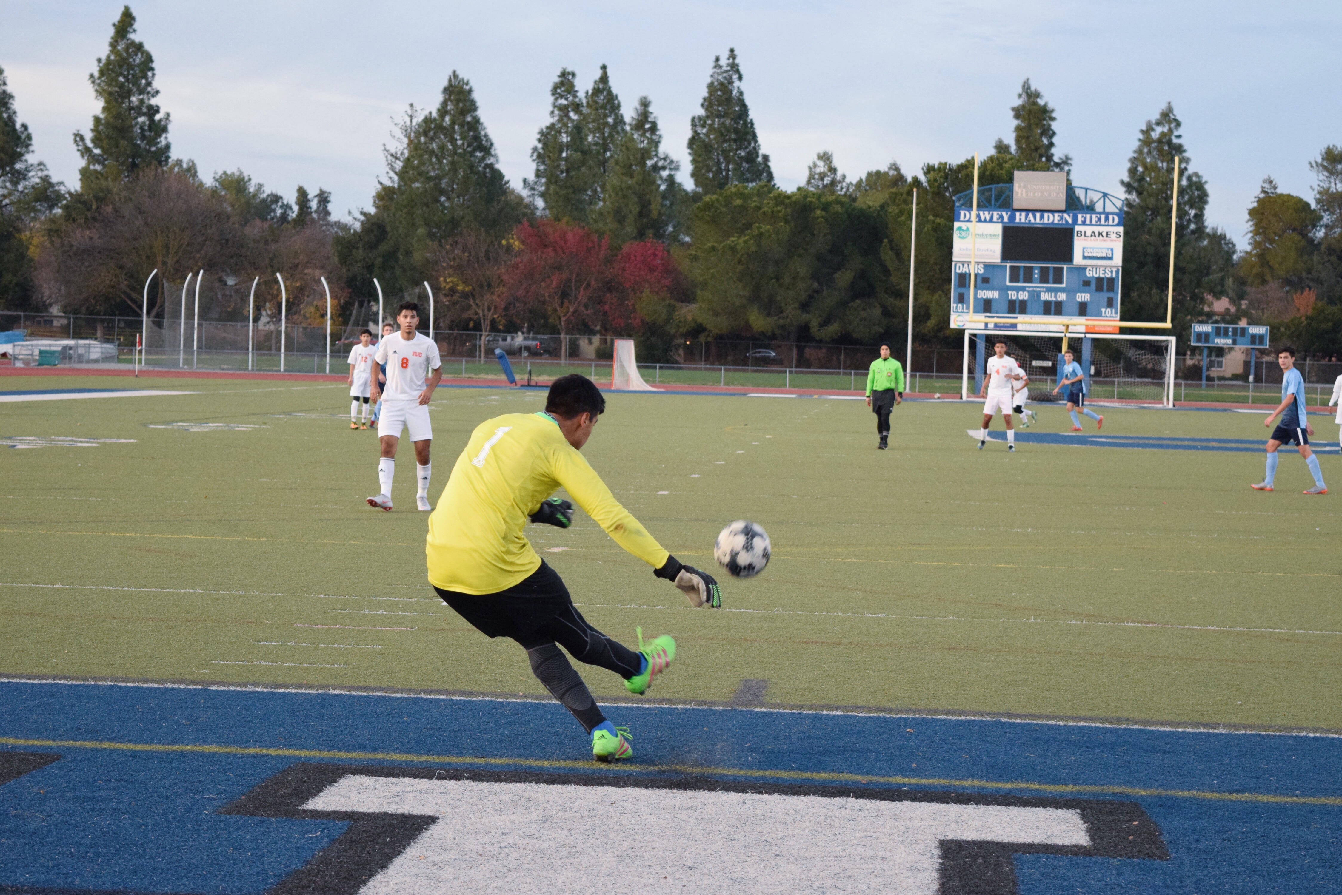 Junior Cory Kodira clears the ball for Davis.