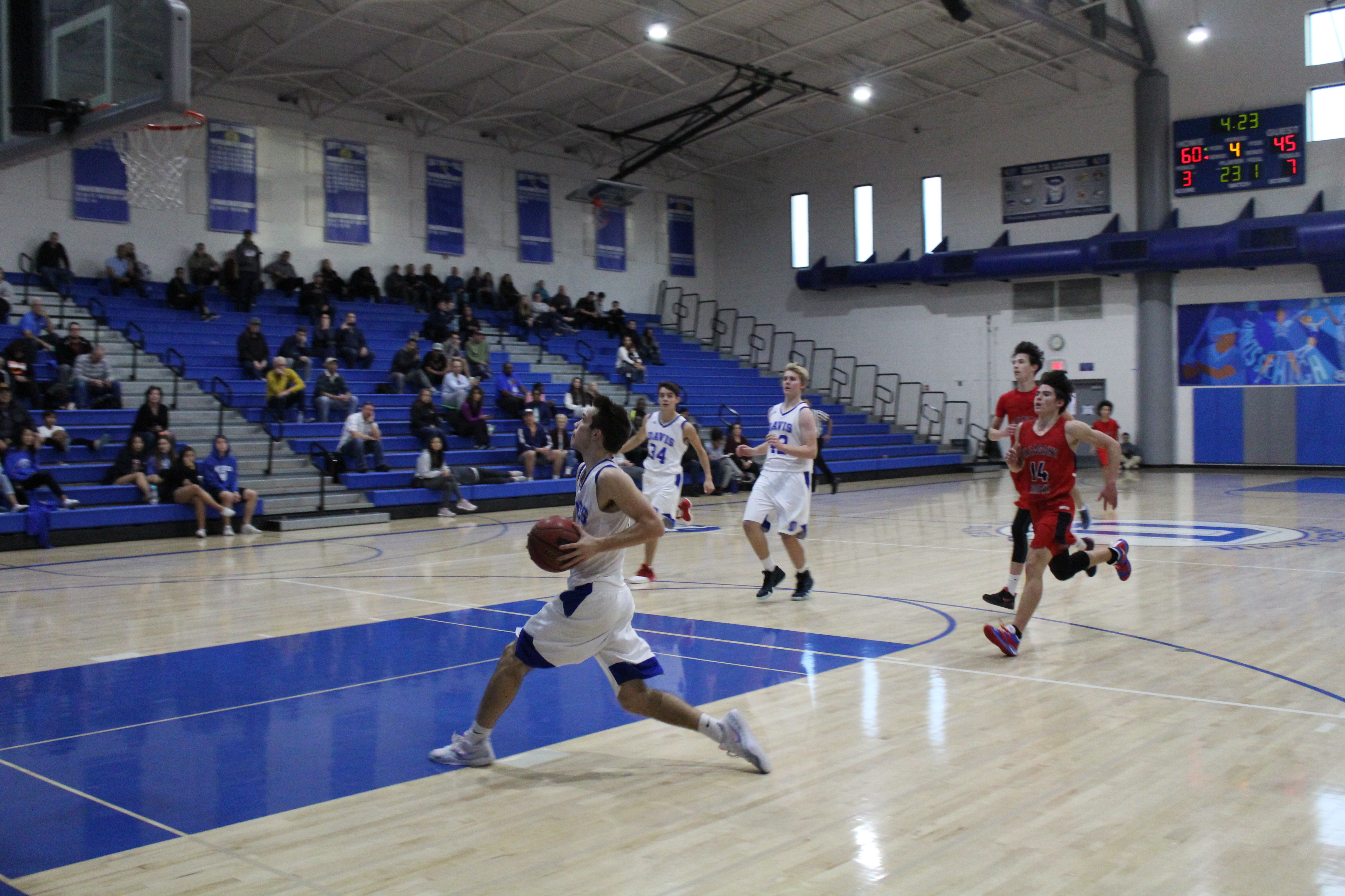 Junior Joey Voss strides toward the basket for two points.