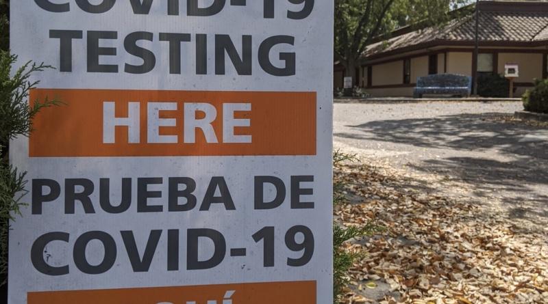 "A sign in front of the Davis Senior Center reading ""COVID-19 Testing Here Prueba De COVID-19 Aquí"""