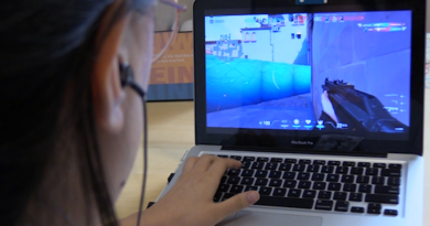 The screen of a laptop shows a Valorant game in play