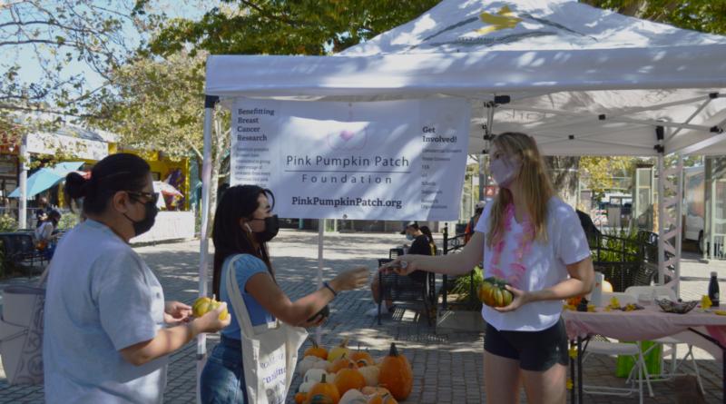 Senior Annika Bastin helping customers buy pumpkins