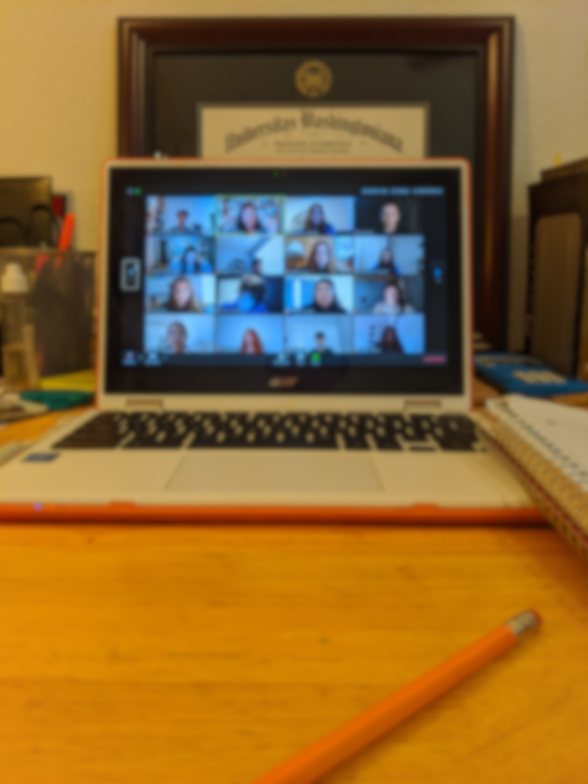 A blurred out Zoom meeting running on a laptop