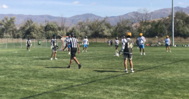 Senior Mason Johnstone and his team on the lacrosse field during a scrimmage game in Utah
