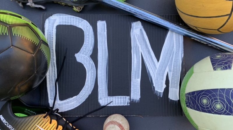 "Sports equipment surround the white paint reading ""BLM"" on the black background"