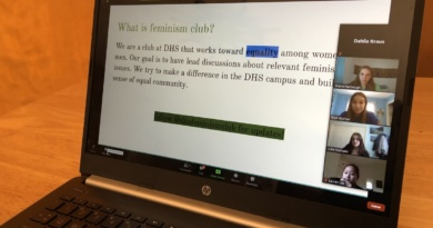 """Feminism Club presidents share their screen of a presentation slide title """"What is Feminism Club"""" during one of the club fair meetings"""