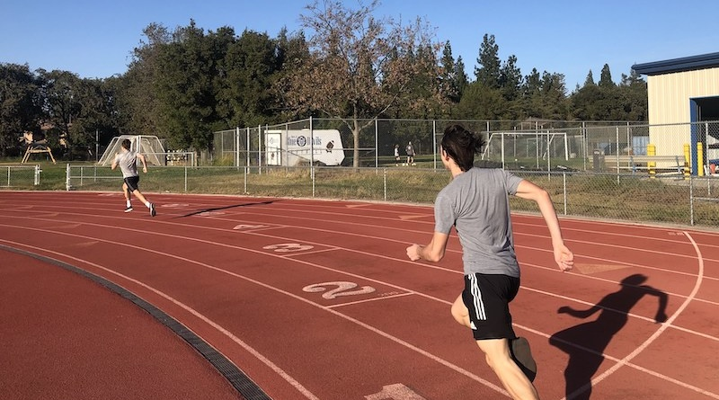 Two high school boys resume track and field practices for the first time since the onset of the pandemic