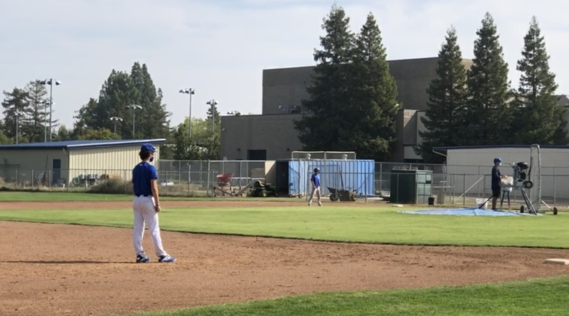 Juniors Ben Hanson and Dylan Rockwell practicing with the varsity baseball team