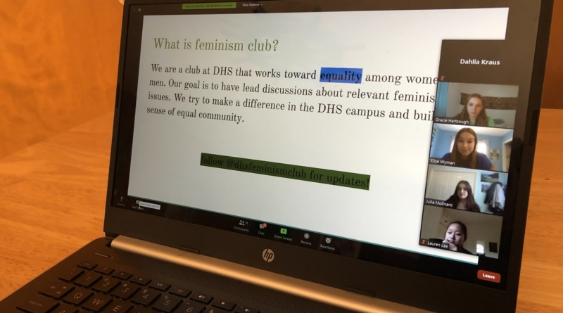 "Feminism Club presidents share their screen of a presentation slide title ""What is Feminism Club"" during one of the club fair meetings"
