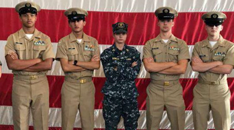 Charlotte Bowler wearing her Coast Guard damage controlman uniform with two cadets on either side