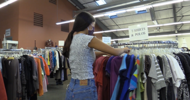 Student sifting through the clothes section at All Things Right and Relevant