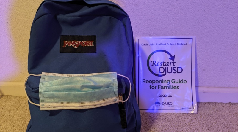 backpack with mask and booklet