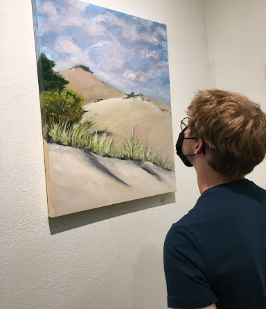 person looks at art